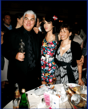 Amy Winehouse, her father Mitch and mother Janis pose with Amy's award for Best Song Musically and Lyrically for 'Love Is A Losing Game' at the 53rd Ivor Novello Awards at the Grosvenor House Hotel on May 22, 2008 in London, England.| Source: Getty Images