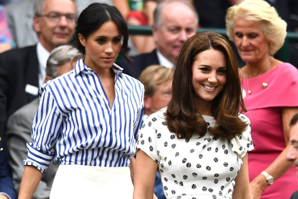 Meghan Markle and Kate find their seats as they attend the Wimbledon Lawn Tennis Championships on July 14, 2018 in London, England | Source: Clive Mason/Getty Images