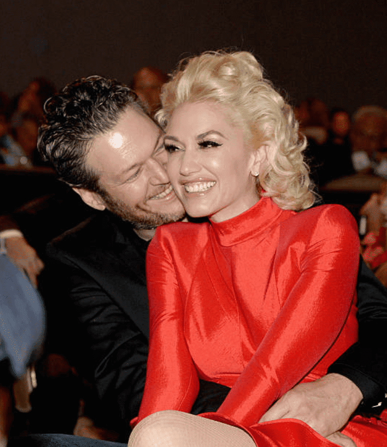 Blake Shelton and Gwen Stefani enjoy valentines day at the 2016 Pre-GRAMMY Gala, at the Beverly Hilton Hotel, on February 14, 2016, in Beverly Hills, California | Source: Getty Images (Photo by Kevin Mazur/WireImage)
