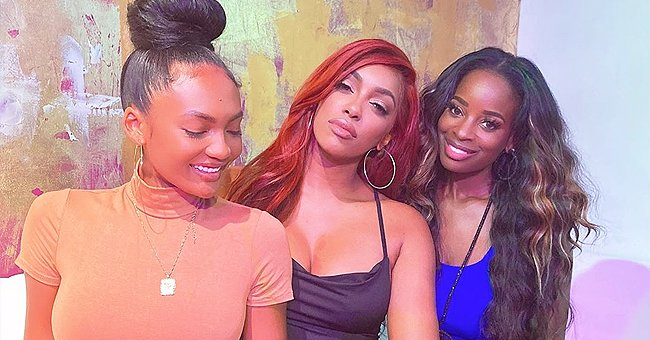 RHOA's Porsha Williams Shows Fit Figure Posing with Friends in Tight Black Dress & New Red Hair