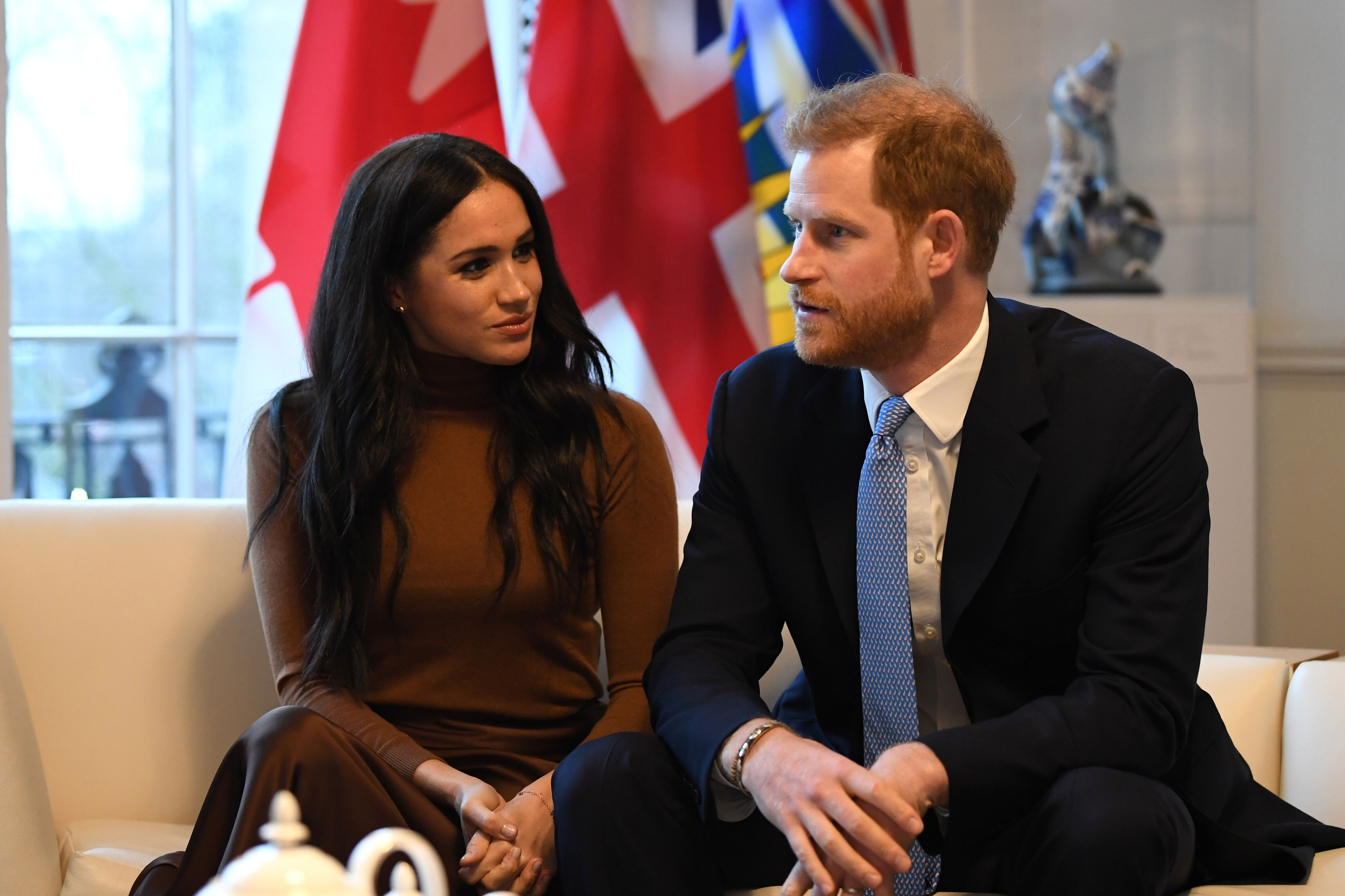 Prince Harry, Duke of Sussex and Meghan, Duchess of Sussex gesture during their visit to Canada House in thanks for the warm Canadian hospitality and support they received during their recent stay in Canada, on January 7, 2020 in London, England | Photo: Getty Images