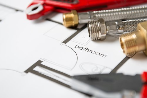 Wrench And Pipes On Bathroom Blueprint. | Source: Shutterstock.