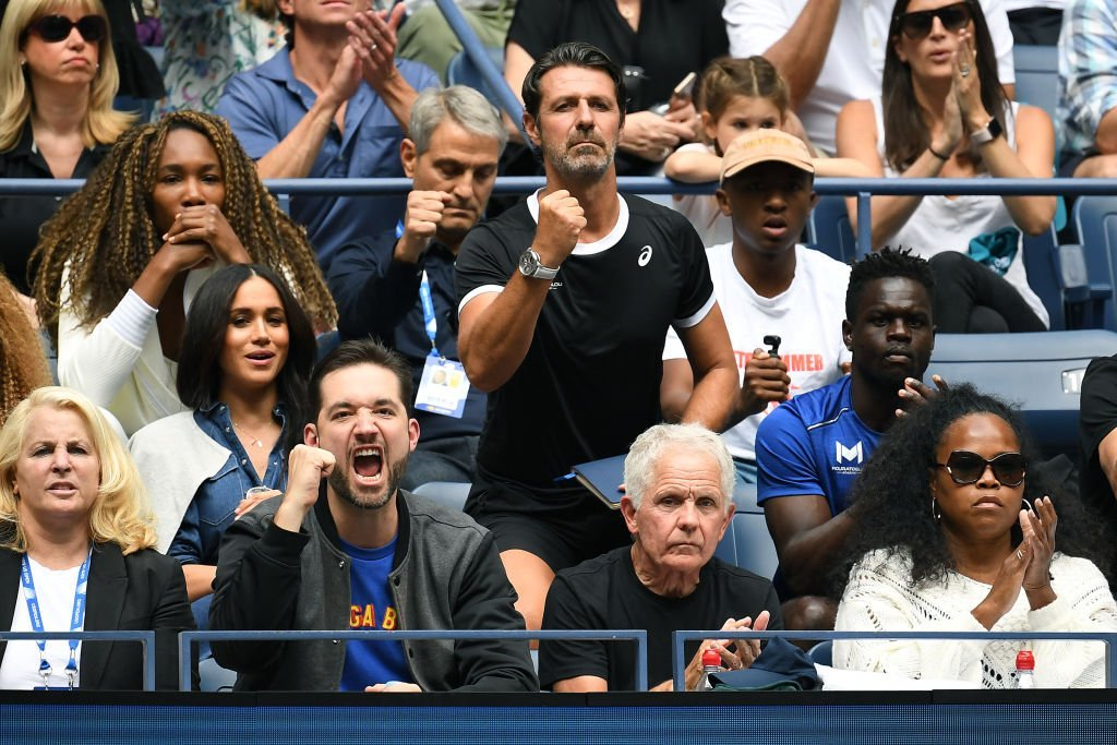 Venus Williams, coach Patrick Mouratoglou, husband Alexis Ohanian, and Meghan, Duchess of Sussex, cheer for Serena Williams of the United States during her Women's Singles final match against Bianca Andreescu of Canada on day thirteen of the 2019 US Open at the USTA Billie Jean King National Tennis Center | Photo: Getty Images
