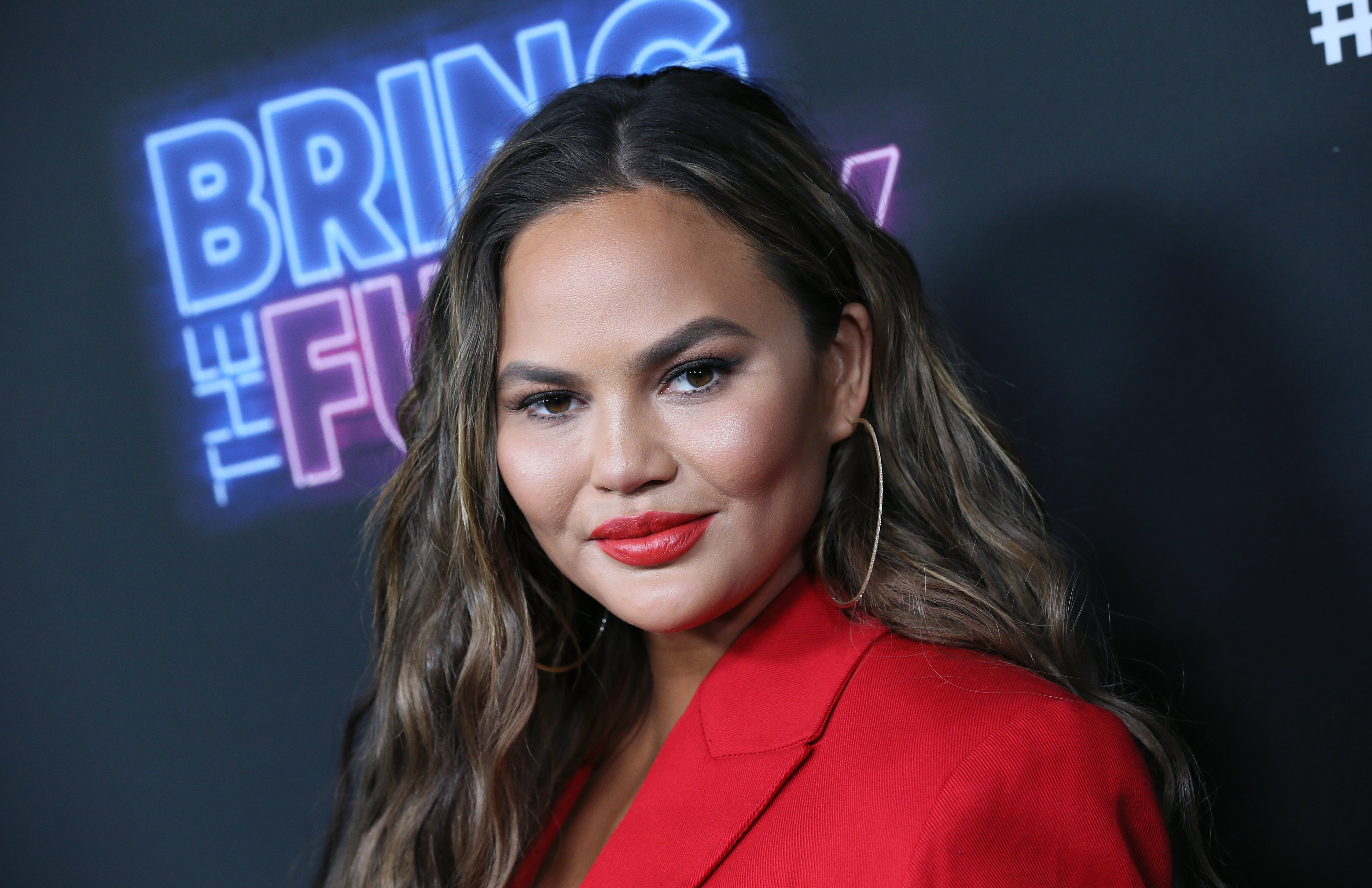 "Chrissy Teigen pictured at the premiere of NBC's ""Bring The Funny"" at Rockwell Table & Stage, 2019, California. 