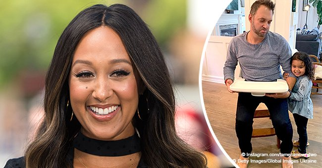 Tamera Mowry shares photo of daughter helping her dad let go of 'the last baby piece' in house