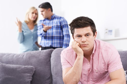 Parents frustrated with their son living at home. | Source: Shutterstock.