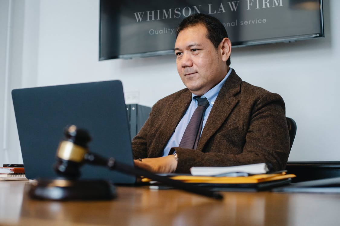 A photo of a lawyer in his office.  |  Source: Pexels