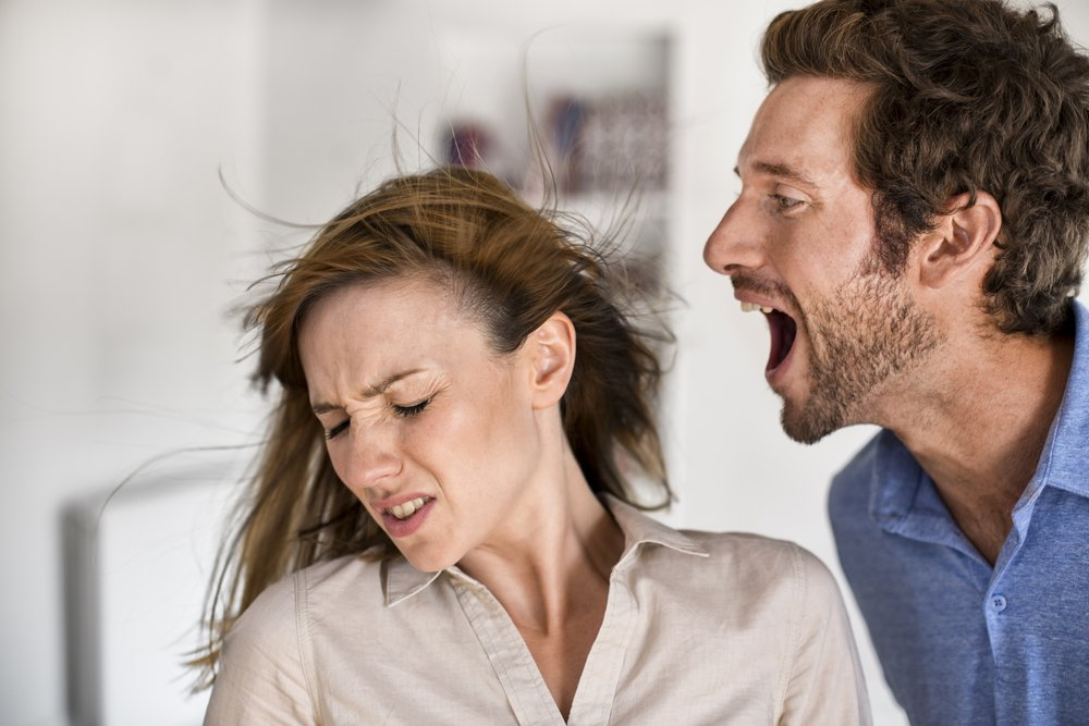 An angry man yelling at a woman. | Photo: Shutterstock