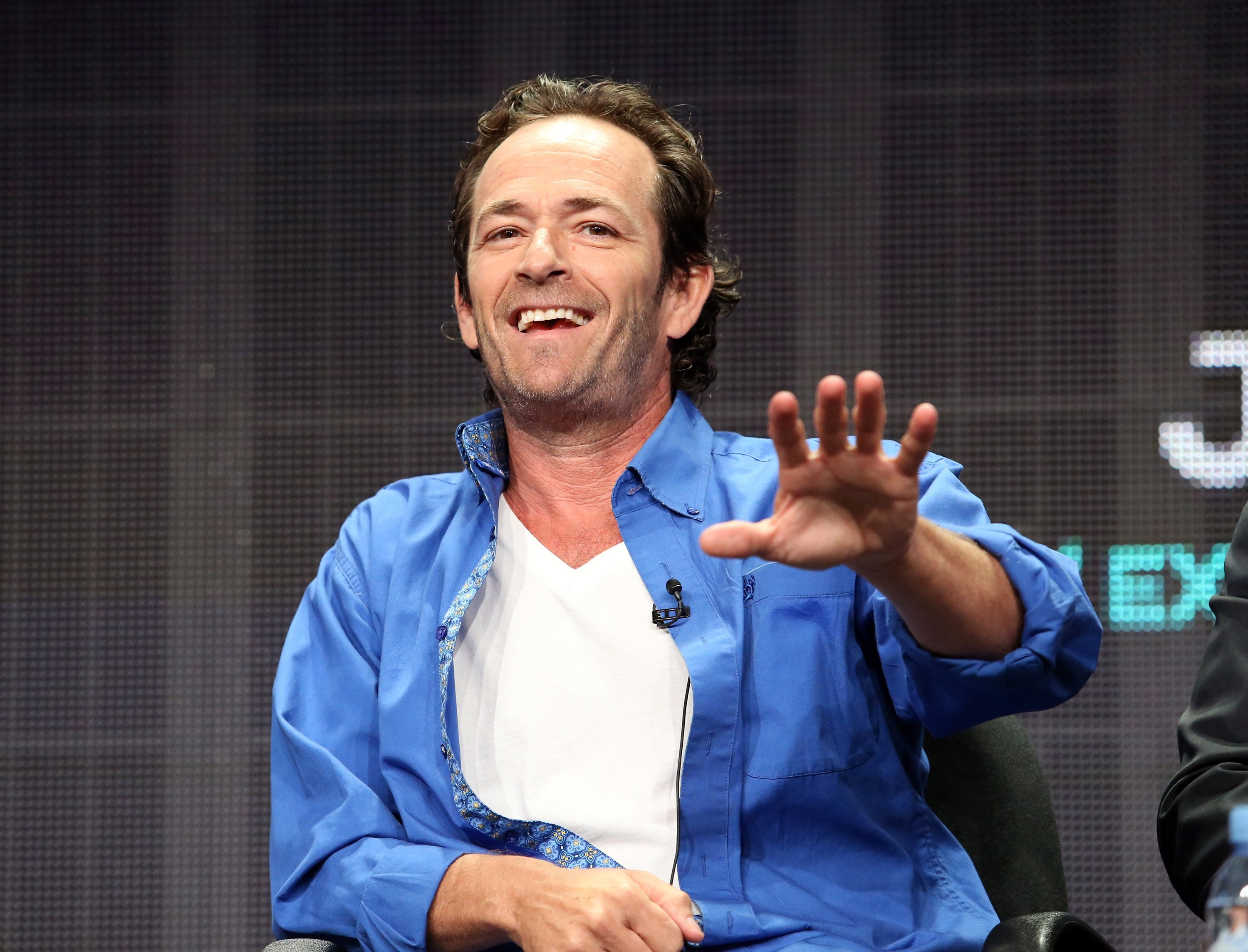 Luke Perry onstage during the 'Welcome Home' panel discussion at the UP Entertainment The Beverly Hilton Hotel in 2015. Image credit: Getty Images/Global Images Ukraine