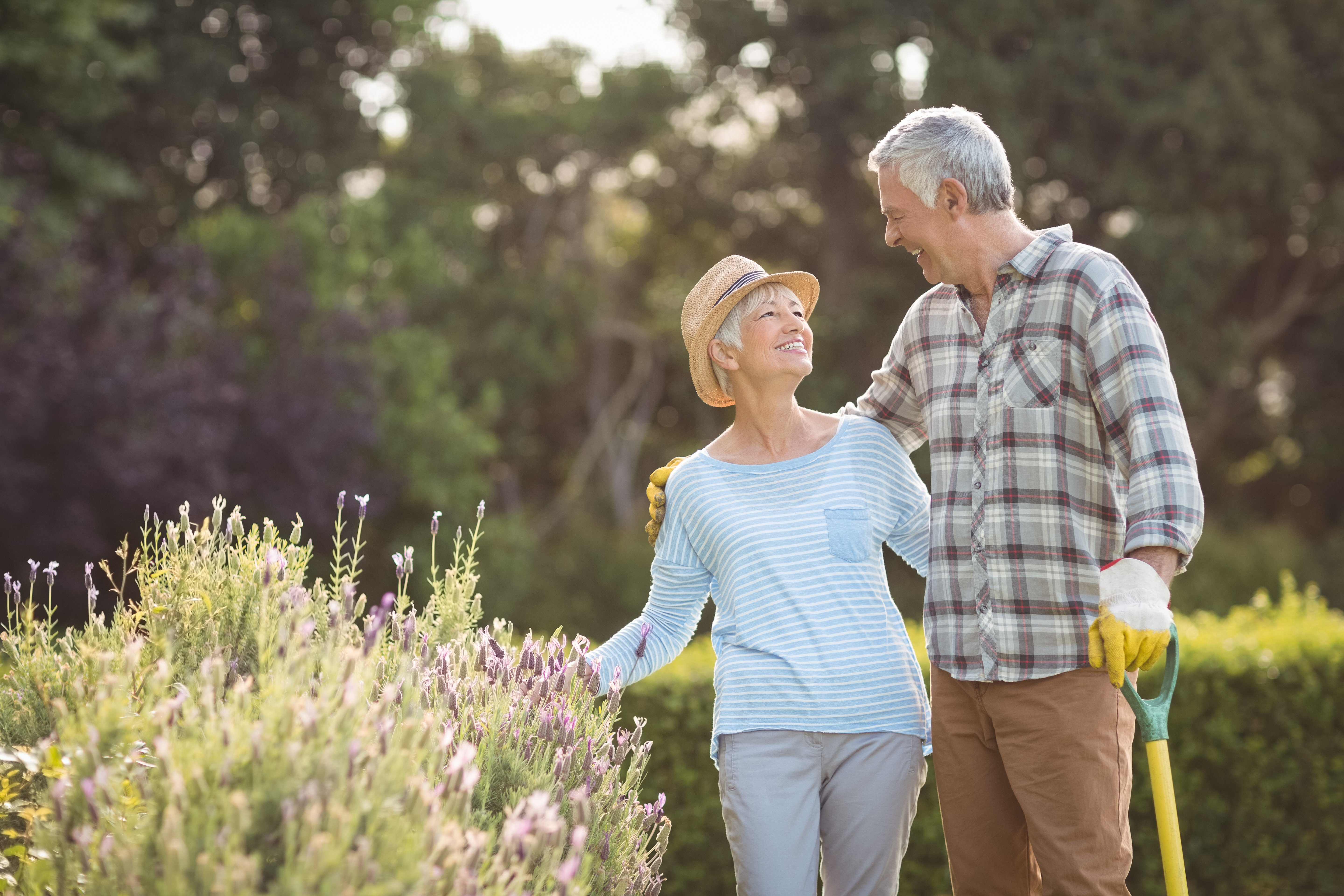 A happy mature man and woman in a garden |Source: Shutterstock