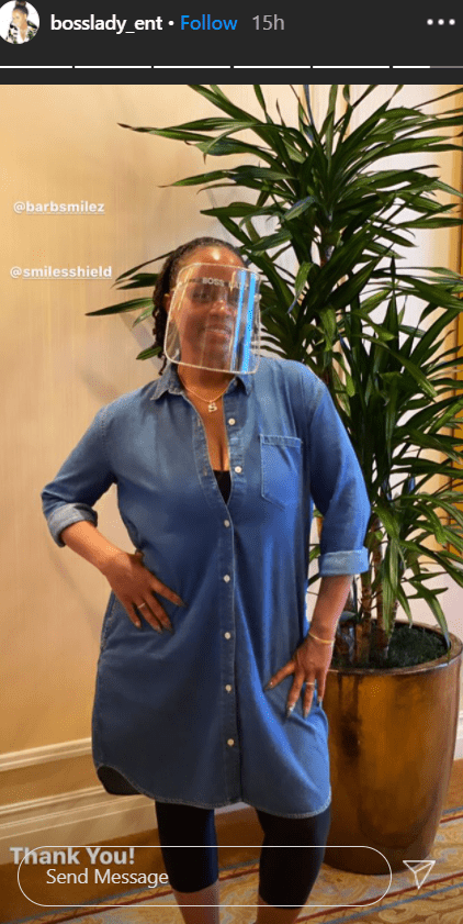 Shante Broadus poses for a picture in a denim dress and a face shield. | Photo: Instagram/bosslady_ent