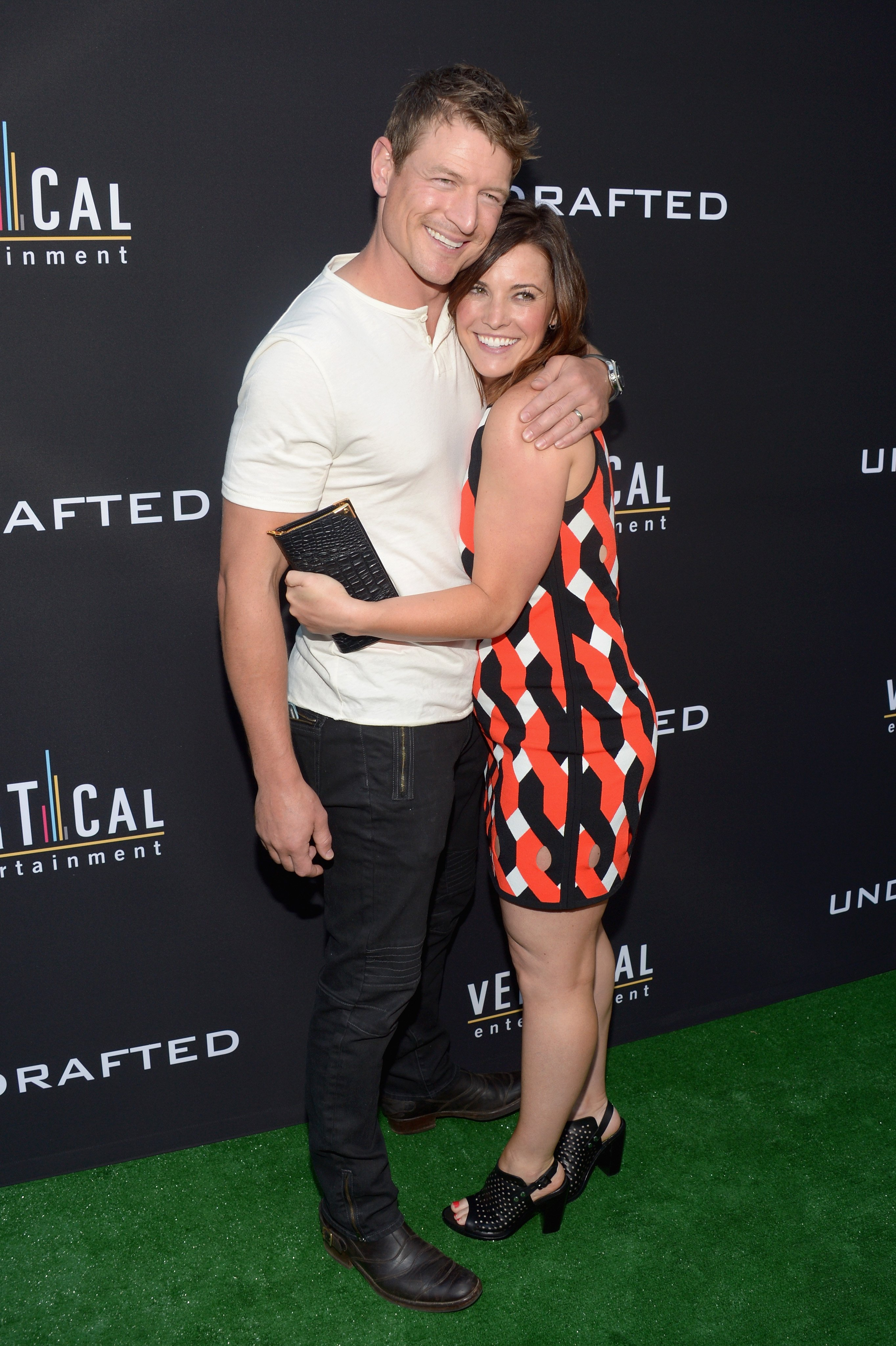 """Philip Winchester (L) and Megan Coughlin attend the premiere of Vertical Entertainment's """"Undrafted"""" at ArcLight Hollywood on July 11, 2016, in Hollywood, California. 