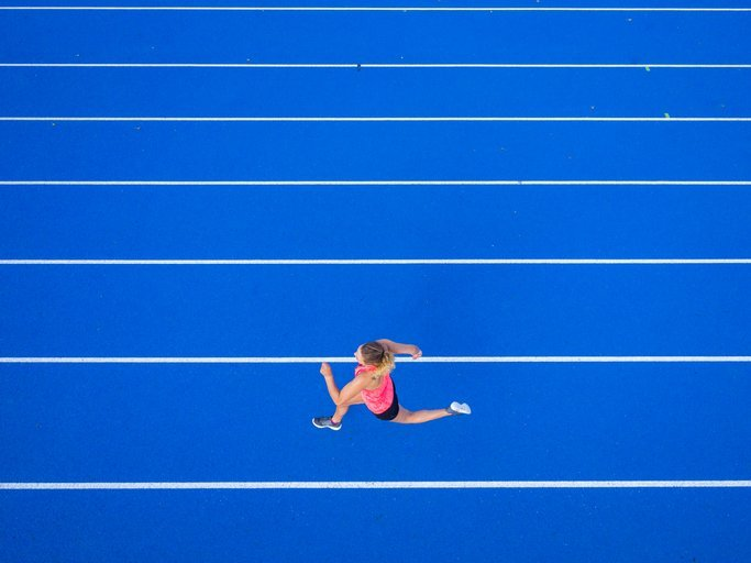 A female runner on tartan track | Photo: Getty Images