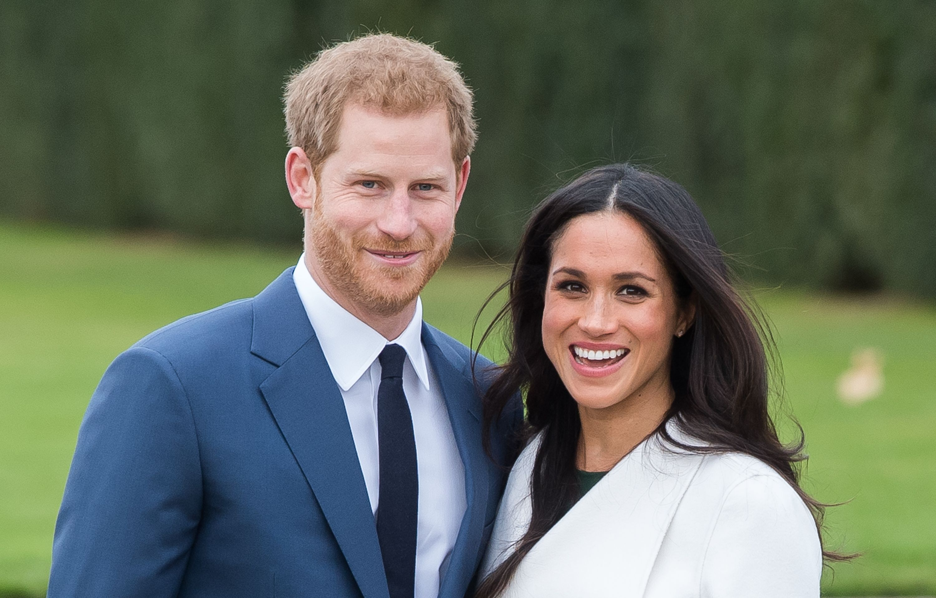 Prince Harry and Meghan Markle during an official photocall to announce their engagement at The Sunken Gardens at Kensington Palace | Photo: Getty Images