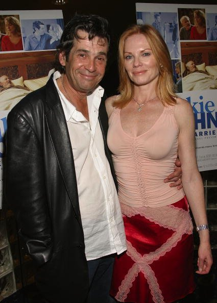 Alan Rosenberg and his wife Actress Marg Helgenberger attend the Premiere of Frankie and Johnny Are Married on June 7, 2004, at Clearview Cheslea West Cinemas, in New York City. | Source: Getty Images.