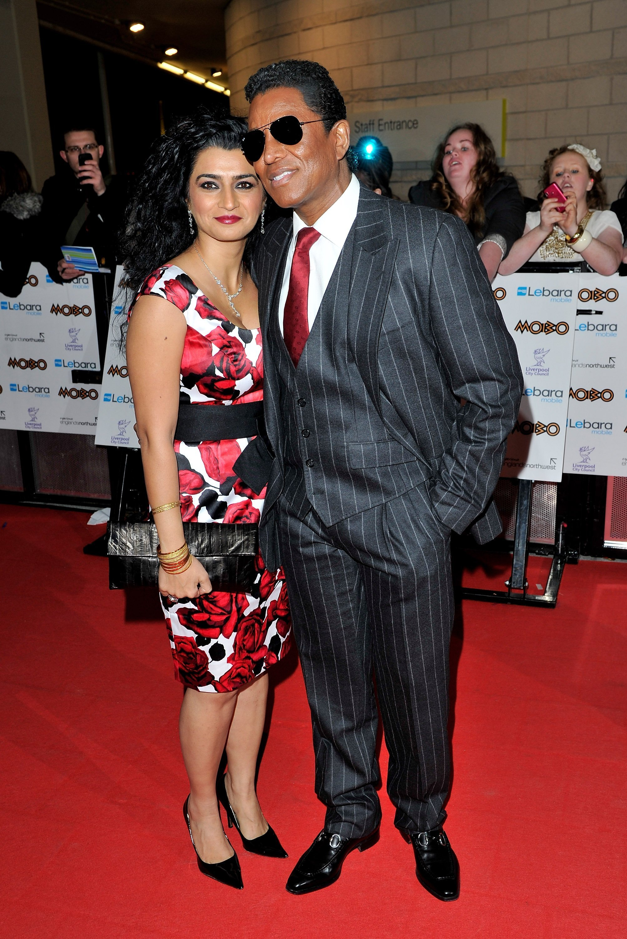 Jermaine Jackson and Hamida Rashid at the red carpet of the MOBO Awards at the Echo Arena in Liverpool, England on October 20, 2010. | Photo: Getty