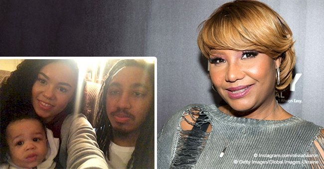 Traci Braxton's son and daughter-in-law are all smiles in picture with their baby boy