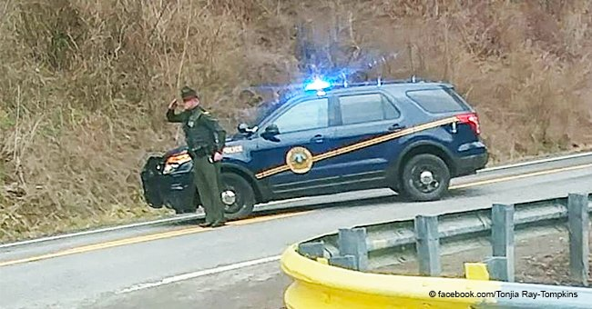 Photo of trooper paying tribute to a funeral procession with a salute quickly goes viral