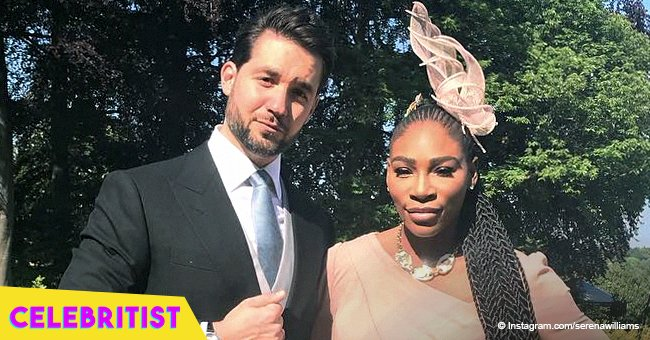 Alexis Ohanian embraces wife Serena Williams while posing on the rooftop of a house