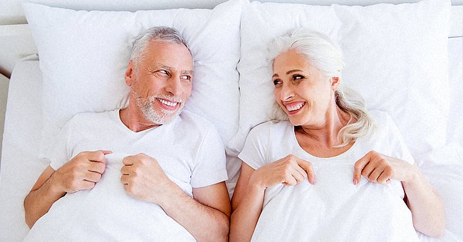 An older couple lying in bed.   Photo: Shutterstock