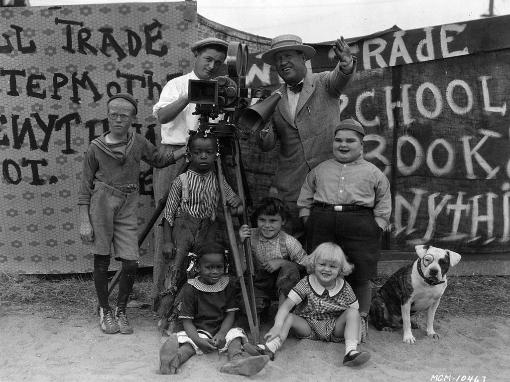 """Film director Robert McGowan and cinematographer Art Lloyd (1896 - 1954) seen with the child stars of his """"Our Gang"""" film series, otherwise known as the """"Little Rascals"""" on January 01, 1928 