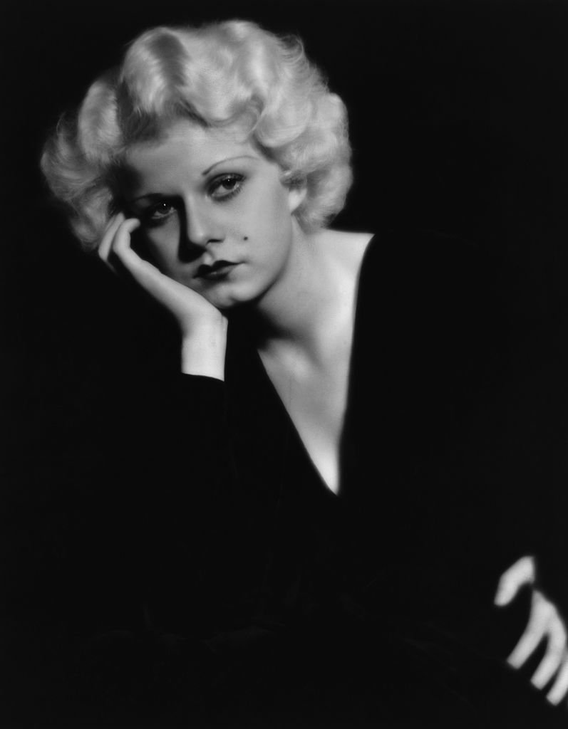 Portrait of Jean Harlow in a pensive pose, wearing a black v-necked dress on January 01, 1930   Photo: Getty Images