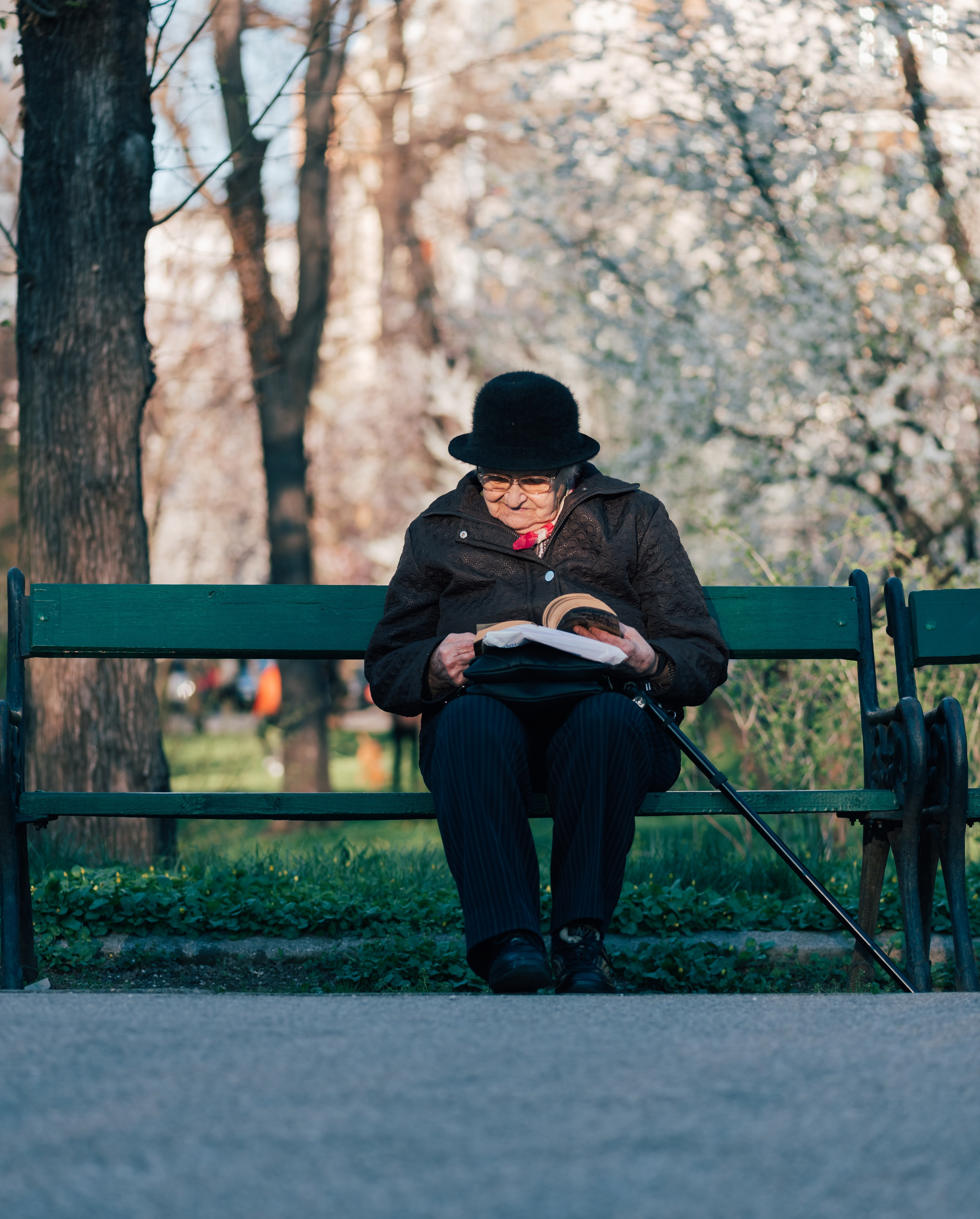 An ageing mother taking a moment to read over her letter| Photo by Alex Blăjan on Unsplash