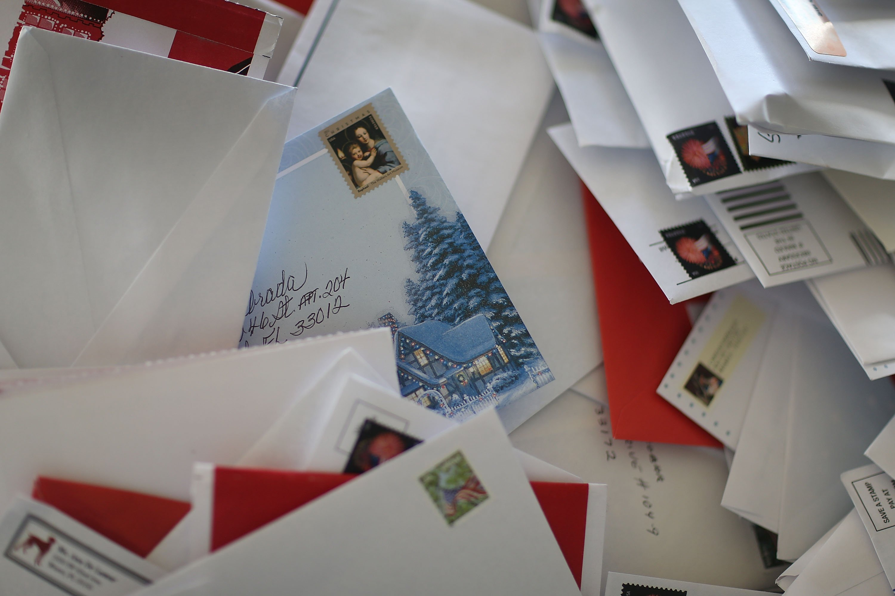 Holiday card among plenty of letters | Source: Getty Images