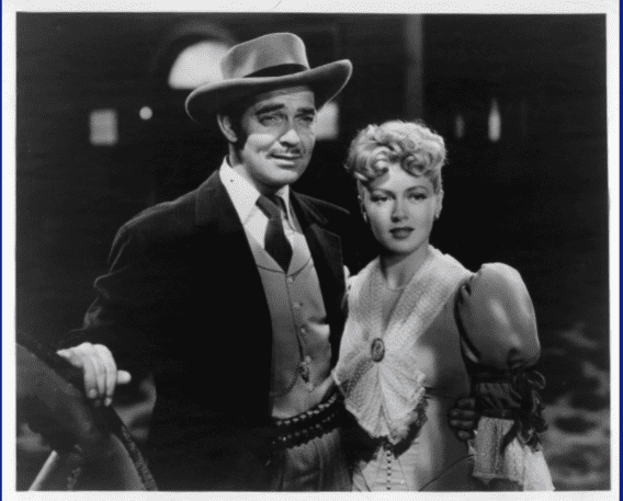 Clark Gable holding Lana Turner in a scene from the film 'Honky Tonk', 1941. | Source: Getty Images