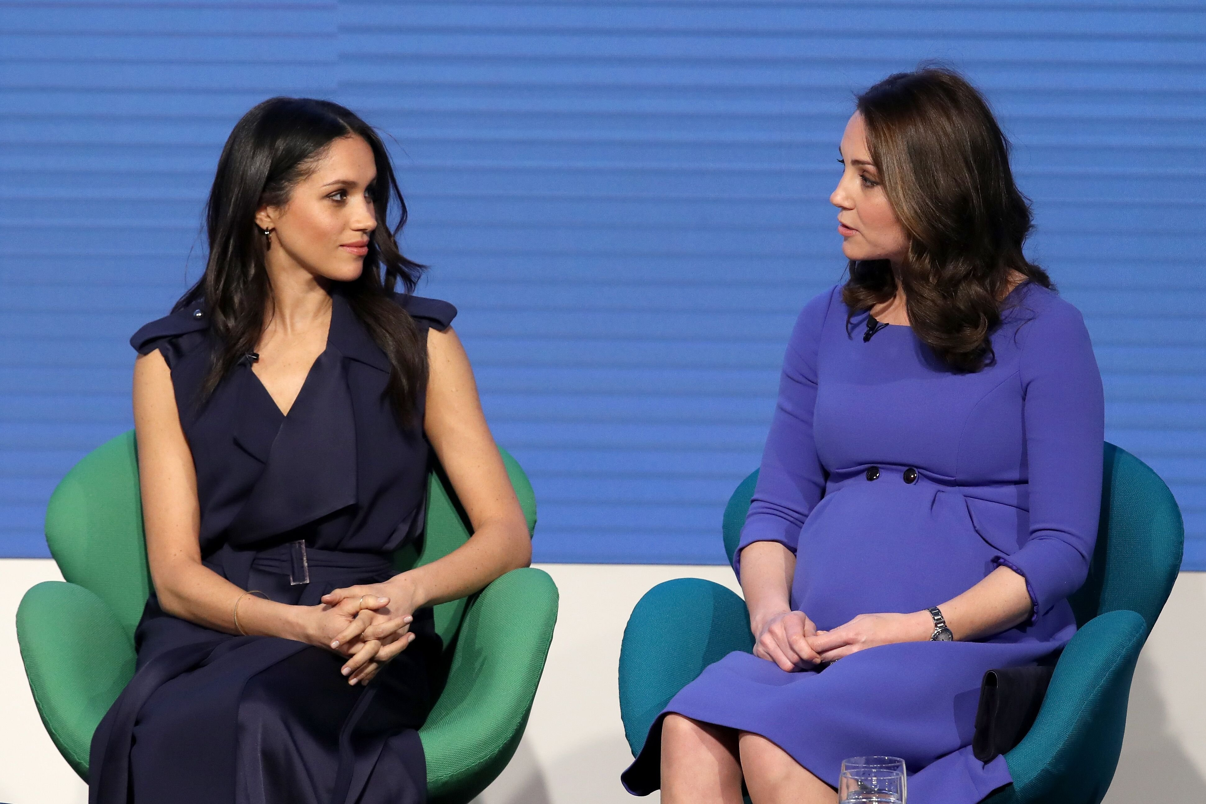 Meghan Markle and Kate Middleton discussing the Royal Foundation. Image credit: Getty/Global Images Ukraine