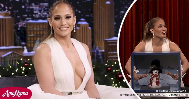 Jennifer Lopez looks like a seductive ballerina, flaunting ample cleavage in a fluffy white dress