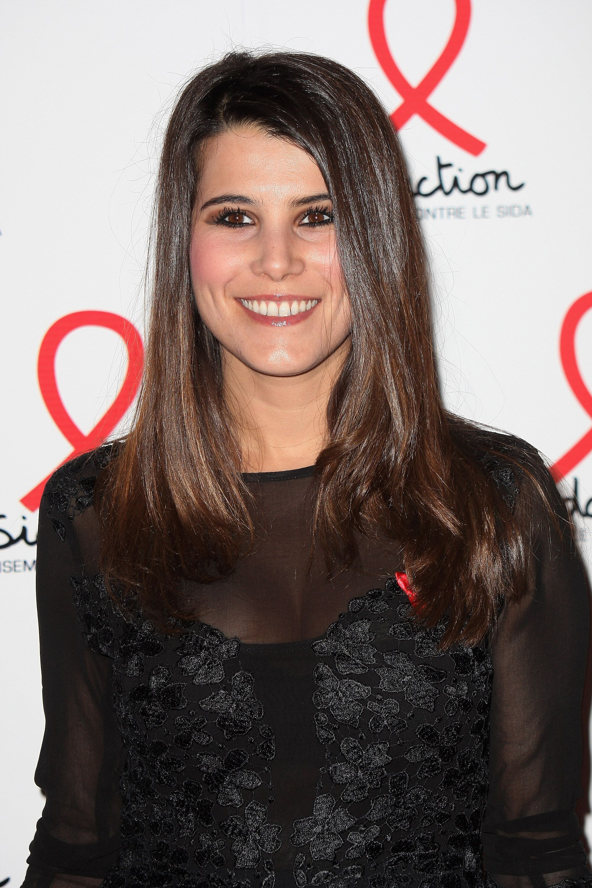 Karine Ferri pose lors du Sidaction 2013.| Photo : GettyImage