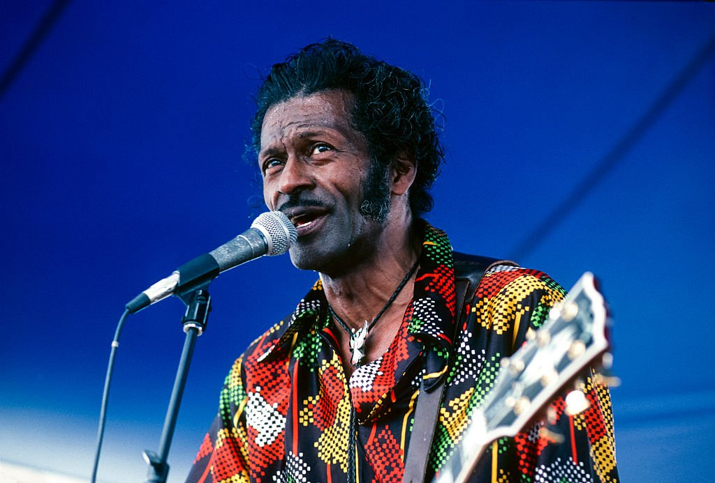American R&B and Rock musician Chuck Berry performs onstage at the New Orleans Jazz & Heritage Festival, May 1981. | Photo: Getty Images