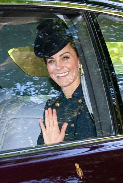 Kate Middleton waves to the crown from inside a car.   Source: Getty Images