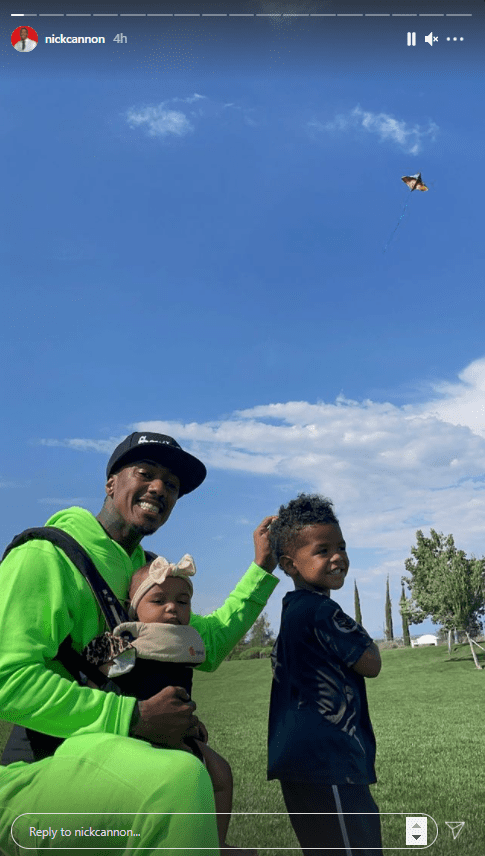 Nick Cannon posing with his son Golden and daughter Powerful Queen. | Photo: Instagram/@nickcannon
