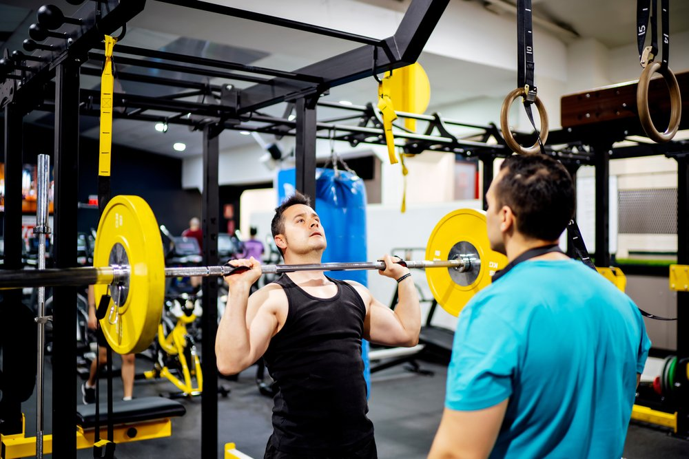 A personal trainer and his client working it out in the gym.   Photo: Shutterstock