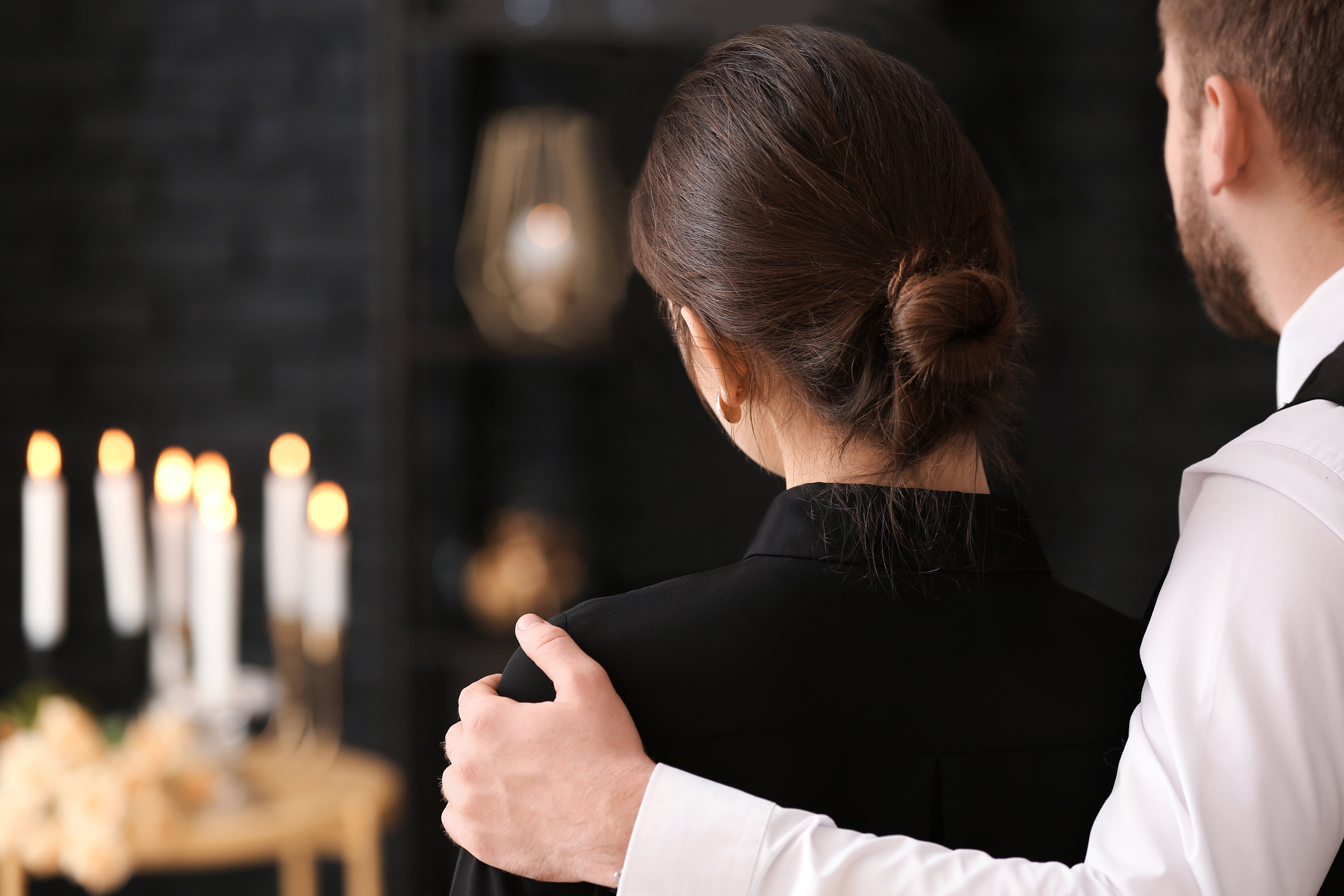 A man and a woman mourning the loss of a loved one | Photo: Shutterstock