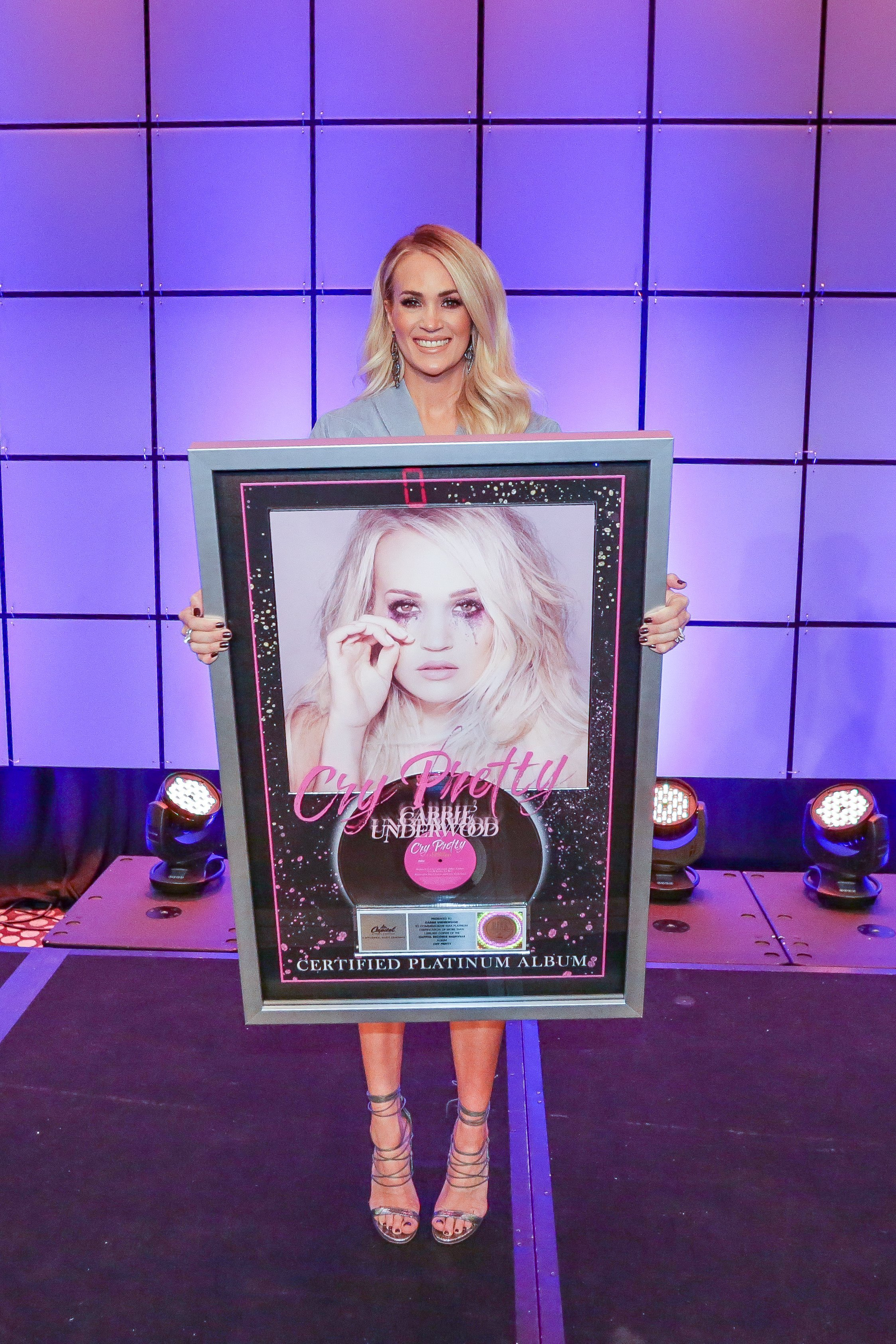 Carrie Underwood with her RIAA Platinum certification for her latest album Cry Pretty in February 2020. | Photo: Getty Images
