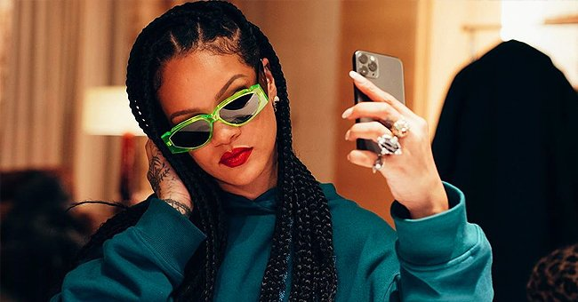 Rihanna Poses in Stylish Electric Green Sunglasses and Rocks Red Lips in a Selfie