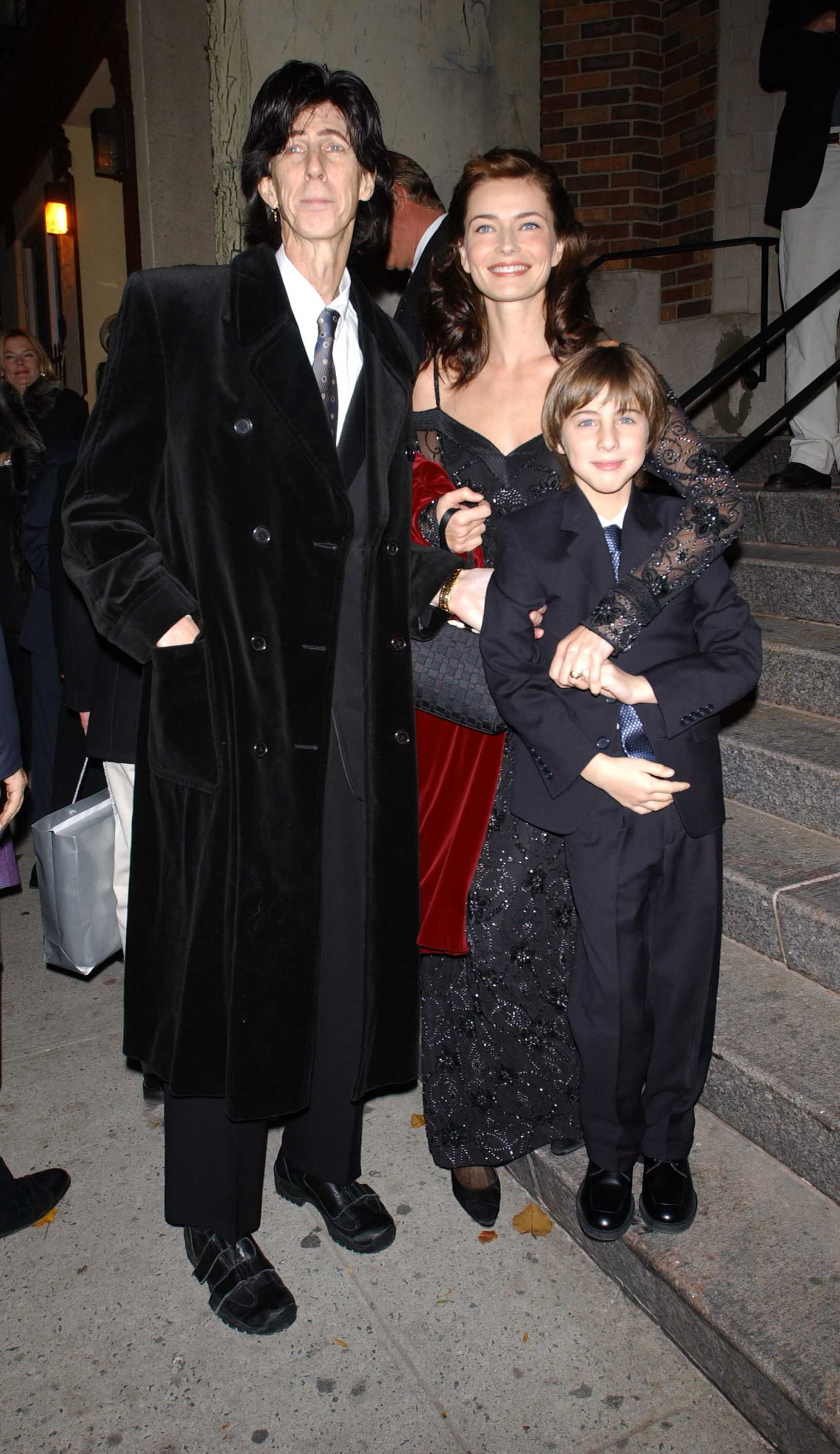 Late Rick Ocassick, Paulina Porizkova and son Jonathan at the Holy Trinty Archdiocesian Cathedral on November 20, 2001 | Photo: Getty Images