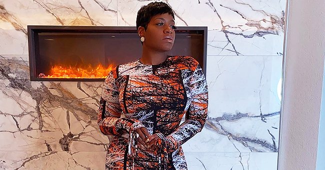 Fantasia Stuns in Long Skintight Dress and High Heels as She Flaunts Curves in a Photo