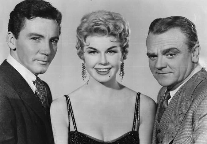 Cameron Mitchell, Doris Day, and James Cagney in a publicity still for Love Me or Leave Me (1955). | Source: Wikimedia Commons