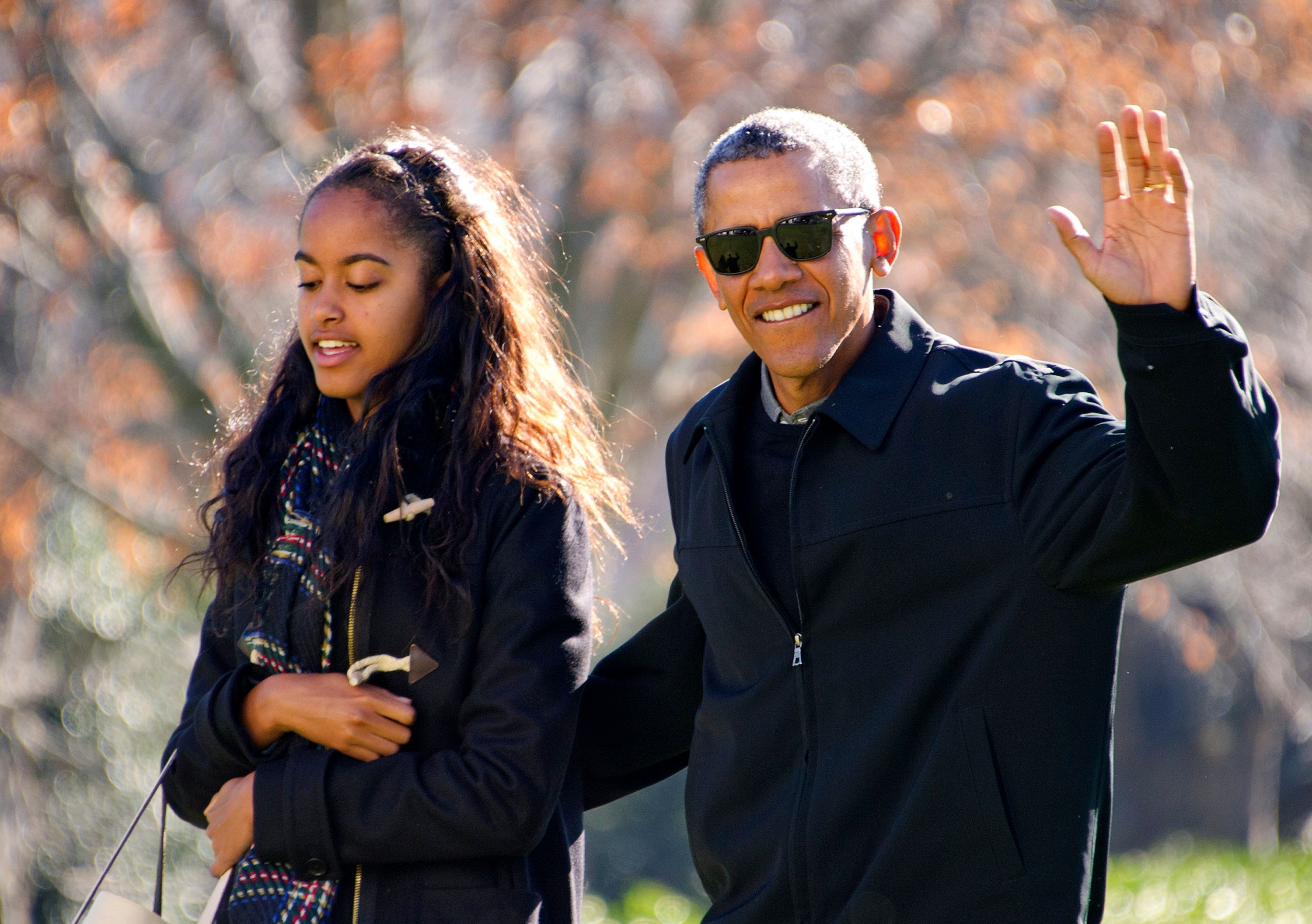 President Barack Obama walks with his daughter Malia on his family's return to the White House on January 3, 2016, in Washington, DC. | Photo: Ron Sachs-Pool/Getty Images