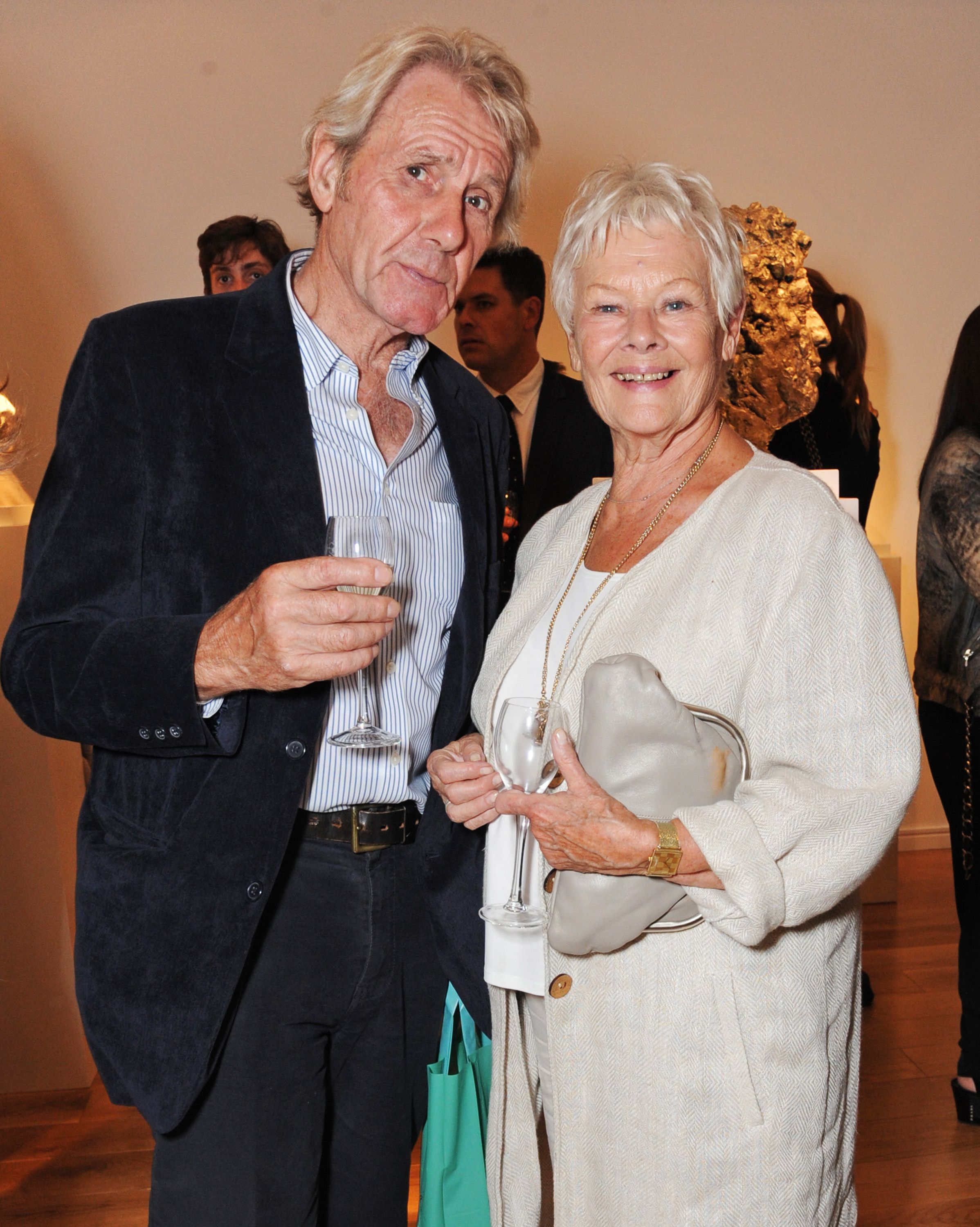 """Dame Judi Dench and David Mills at Nicole Farhi's debut exhibition """"From The Neck Up"""" in 2014 in London, England 
