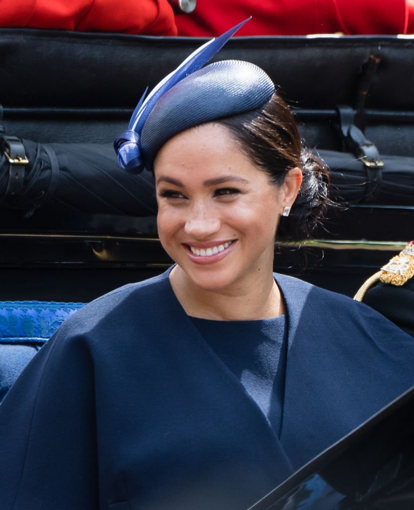 Meghan Markle pictured riding a carriage down the Mall during Trooping The Colour, the Queen's annual birthday parade, 2019, London, England. | Photo: Getty Images