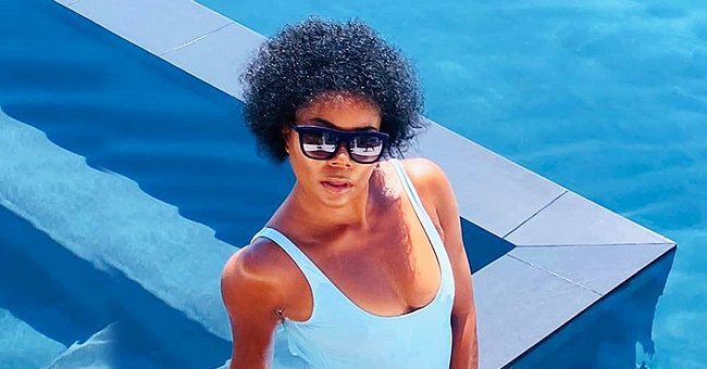 Gabrielle Union Flaunts Her Fit Figure in a Sky Blue Swimsuit While Posing by the Pool