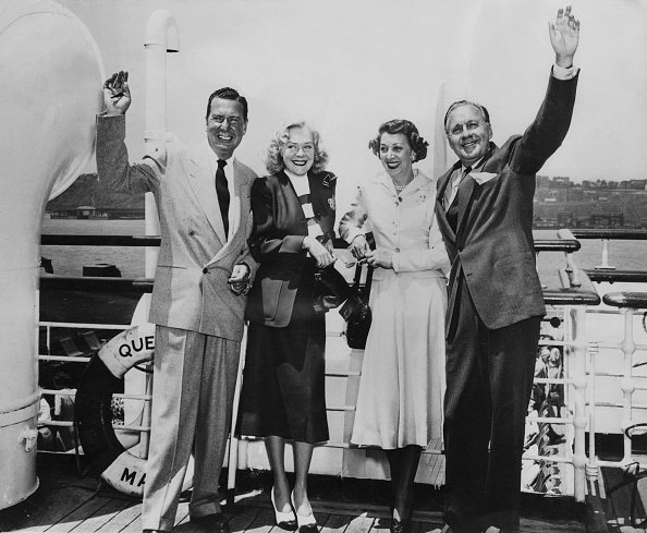 Phil Harris, his wife, Alice Faye with actor Jack Benny and his wife, Mary Livingstone, on board the liner 'Queen Mary' on 12th June 1950 | Photo: Getty Images