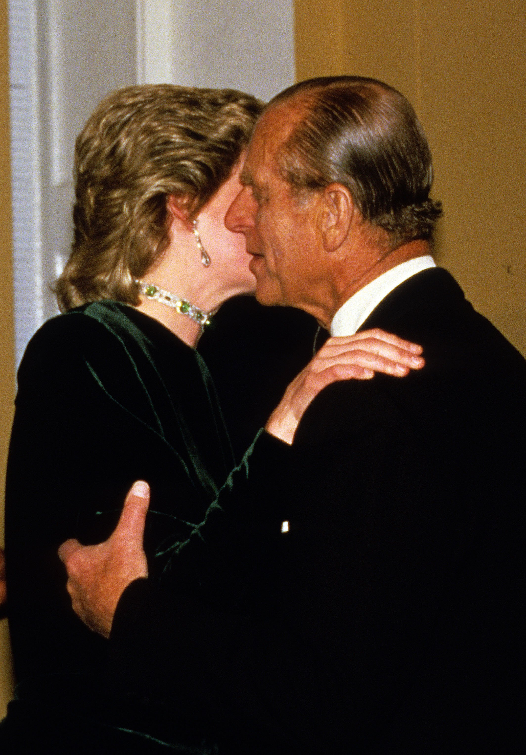 Prince Philip, Duke of Edinburgh receives a kiss from Diana, Princess of Wales in London   Photo: Getty Images
