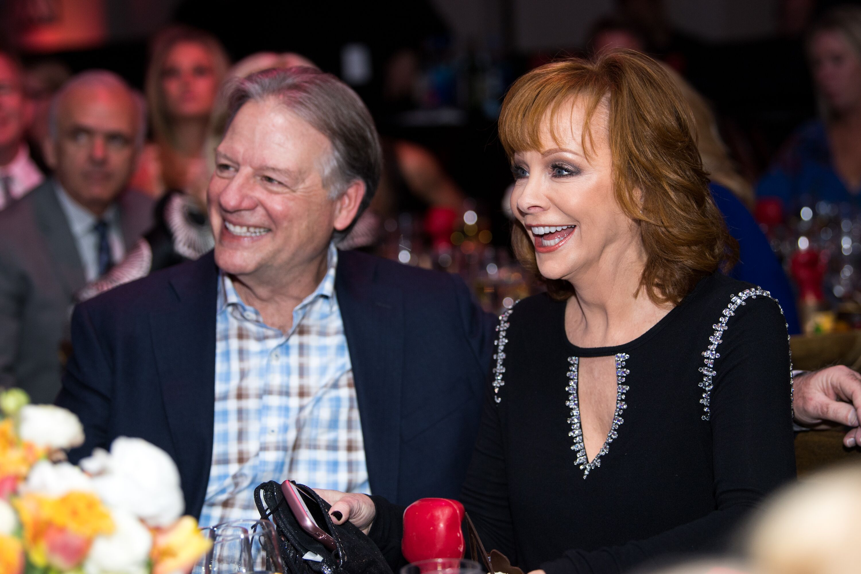 Anthony Lasuzzo and Reba McEntire attend the Celebrity Fight Night's Founders Club Dinner. | Source: Getty Images