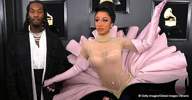 Twitter reacts to Cardi B's unusual Grammy outfit that required multiple people to help her walk